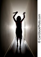 horror silhouette with knife - dark silhouette of woman with...