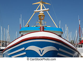 Bow of a fishing ship in a Dutch harbor