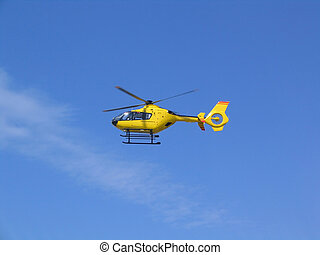 Yellow helicopter in the air - Small yellow helicopter in...