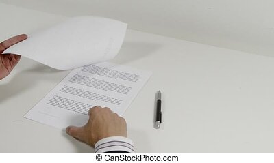 Businessman signing contracts - Businessman signing a two...
