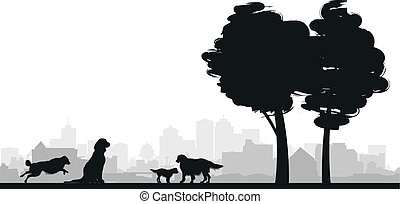 dog silhouettes - four dogs on a grass background