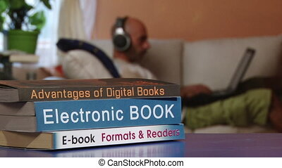 Electronic book, man with headphones