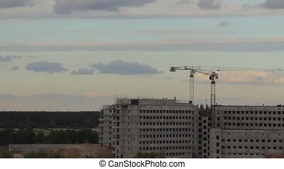 tower cranes building a house