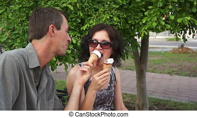 Playful Couple Eating Ice Cream