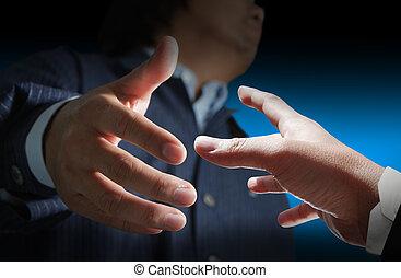Young stylish businessman touching virtual interface button...