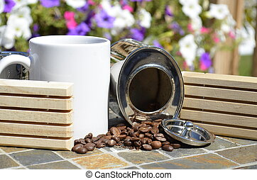 White mug and coffee beans - White coffee mug and a canister...