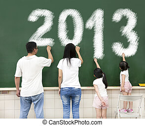 happy family drawing 2013 on the chalkboard