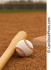 Baseball & Bat on the Infield Dirt