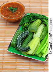 Blanched vegetables and sauce.