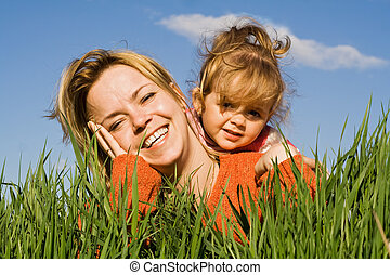 Woman and little girl in the grass - Woman and little girl...