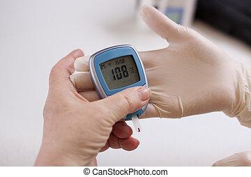 Geriatric nurse measures the glucose level - Geriatric nurse...