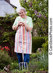 Seniorin bei der Gartenarbeit - Pensioner in the garden with...