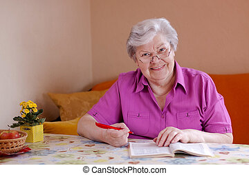 smiling elderly woman looks to the viewer - elderly woman...