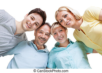 Happy family looking down - Happy family standing in a...