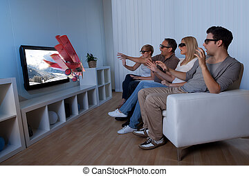 Family watching 3D television - Conceptual image of a family...