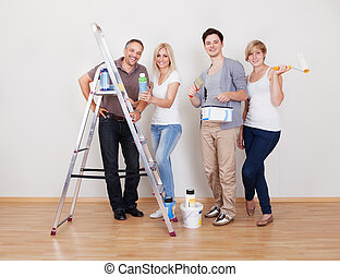 Home maintenance repair team with all four members of the...