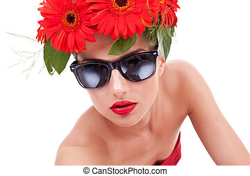 woman with red gerbera flowers in hair