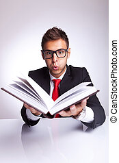 man blowing wonders from a book
