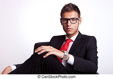 serious young business man seated