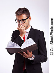 business man reading the thriller book