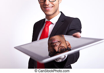 business man offering to you a touch screen pad