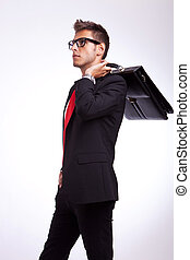 young business with suitcase on his shoulder
