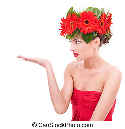 Beautiful young woman with flowers on her head