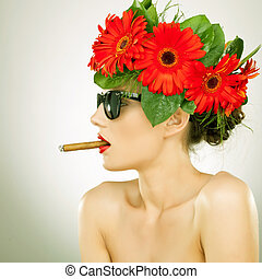 side view of a relaxed sexy woman smoking - side view of a...