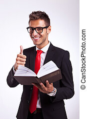 young business man reading about success
