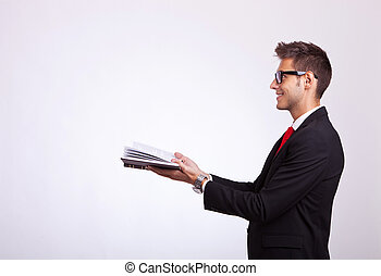 student looking at something imaginary comming out of book -...