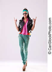 rock and roll baby! - Attractive young woman in sunglasses...