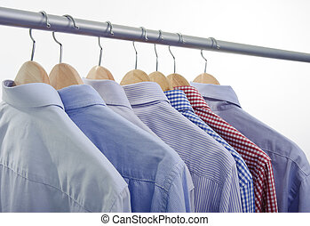 shirts hanger - clothes hanger with shirts isolated on white...