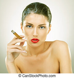 Smoking kills - portrait of attractive young woman smoking...