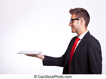 young business man holding a touch screen pad