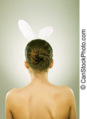 back of a woman with bunny ears