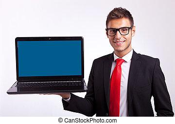 business man holding laptop