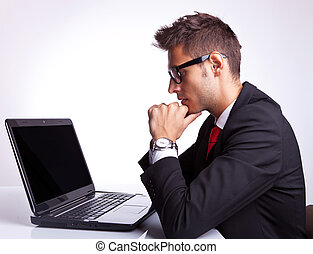 business man working on laptop computer