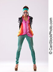 woman wearing leather jacket and high heels posing