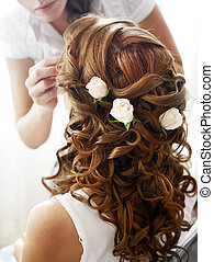 Hairdress of the bride decorated with flowers