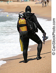 Frogmen - Frogman with aqualungs on a coast of the...