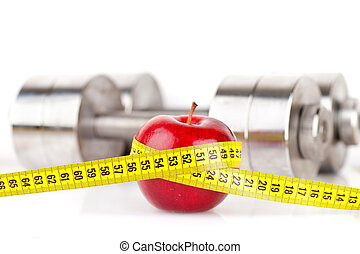 Dumbbells with an apple