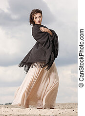 attractive and sensuality woman dancing in the desert -...