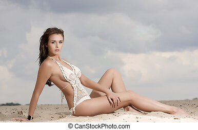 young fashion pretty sexy woman on the beach