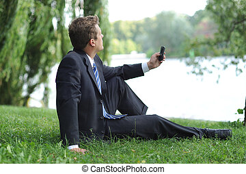 Businessman having a break in the park