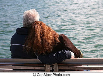 On seacoast - Elderly the man with the young girl on...