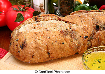 Olive Bread Loaf in Kitchen - Whole olive bread loaf with...