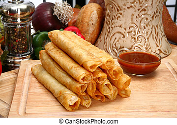 Chicken Taquitos - Stack of chicken taquitos with hot sauce...
