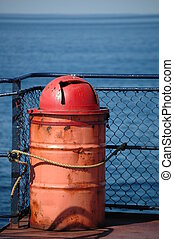 Garbage Can at Sea - Rusted garbage can on deck of...