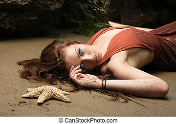 The young woman on a beach.