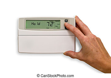 Adjusting Thermostat - Adjusting temperature in thermostat...